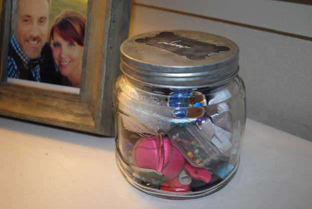 I keep this jar on our dresser in our closet for quick clothing repairs.