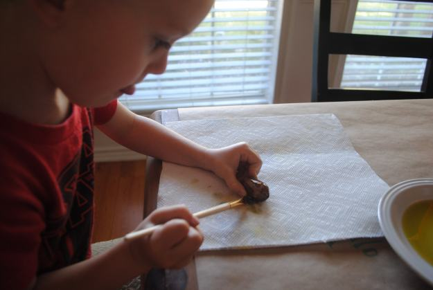 Look at that concentrate face!  He takes craftin' seriously!